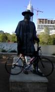 Steve Ray Vaughn holds my bike.