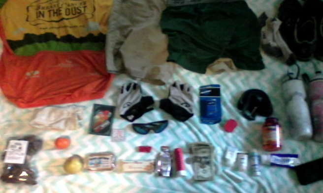 pre-ride stuff on bed photo