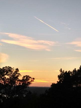 Sun set and jet trail.