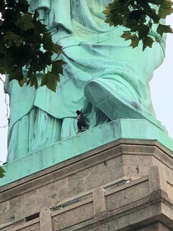 Statue of liberty protestor