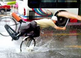 bicyclist falling in rain